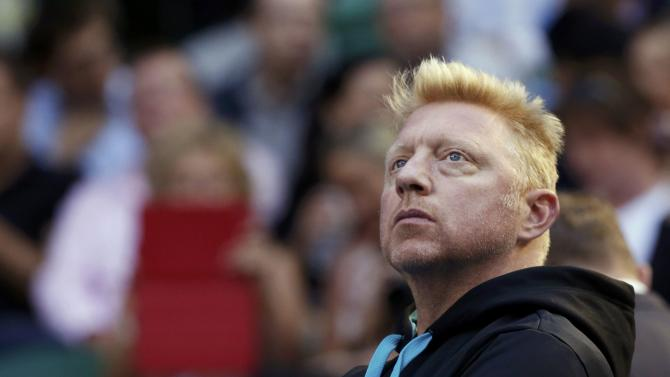 Boris Becker of Germany, coach of Novak Djokovic of Serbia, watches his men's singles quarter-final match against Stanislas Wawrinka of Switzerland at the Australian Open 2014 tennis tournament in Melbourne