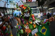 "<p>An activist with a Brazilian national flag and a sign reading ""Long live nature"" takes part in the ""Global March"" in Rio de Janeiro, Brazil, in the framework of the UN Rio+20 Conference on Sustainable Development.</p>"