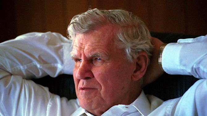 FILE - In this March 15, 2000 file photo, master flatpicker Doc Watson, talks about his long and successful musical career at his home in Deep Gap, N.C. Watson was in critical condition Thursday, May 24, 2012, at a North Carolina hospital after falling at his home in Deep Gap earlier this week.  (AP Photo/Karen Tam, File)