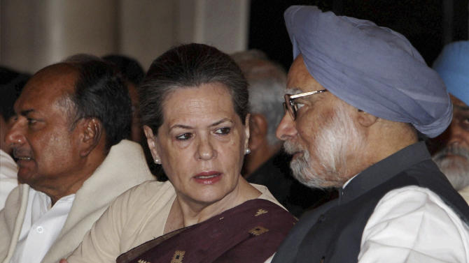 Indian Prime Minister Manmohan Singh, right, talks to Congress party president Sonia Gandhi as Defense Minister A.K. Antony, left, looks away during the swearing-in ceremony for the new ministers in New Delhi, India, Sunday, Oct. 28, 2012. India's Prime Minister Manmohan Singh reshuffled his Cabinet on Sunday in a bid to overhaul his government's image ahead of state and national elections over the next 18 months. (AP Photo)