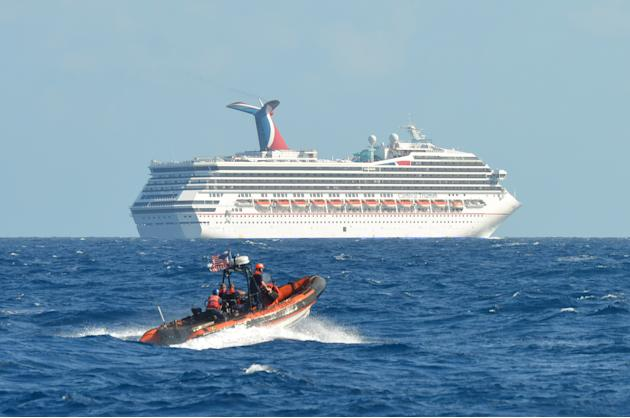 In this image released by the U.S. Coast Guard on Feb. 11, 2013, a small boat belonging to the Coast Guard Cutter Vigorous patrols near the cruise ship Carnival Triumph in the Gulf of Mexico, Feb. 11,