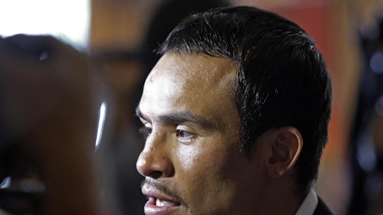 Juan Manuel Marquez, of Mexico, talks to reporters to promote his upcoming boxing match against Manny Pacquiao at a news conference in Beverly Hills, Calif., Monday, Sept. 17, 2012. The two will fight for the fourth time on Dec. 8 in Las Vegas. (AP Photo/Reed Saxon)