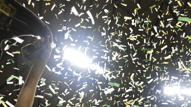 Baylor 's Brittney Griner (42) celebrates their the Big 12 Conference Championship following an NCAA college basketball game against Texas Saturday, Feb. 23, 2013, in Waco, Texas. Baylor defeated Texas 67-47. (AP Photo/Tony Gutierrez)