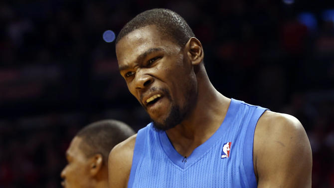 Oklahoma City Thunder's Kevin Durant (35) reacts after being charged with a foul against the Miami Heat during the second half of an NBA basketball game in Miami, Tuesday, Dec. 25, 2012. The Heat won 103-97. (AP Photo/J Pat Carter)