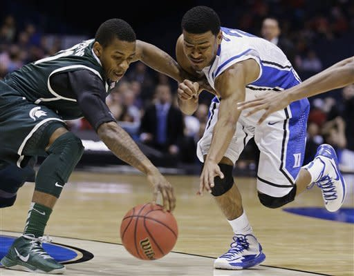 Curry sends Duke past Michigan State 71-61