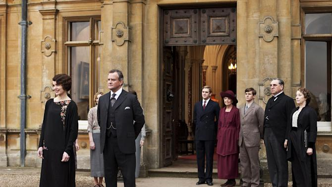 """This undated publicity photo provided by PBS shows, from left, Elizabeth McGovern as Lady Grantham, Hugh Bonneville as Lord Grantham, Dan Stevens as Matthew Crawley, Penelope Wilton as Isobel Crawley, Allen Leech as Tom Branson, Jim Carter as Mr. Carson, and Phyllis Logan as Mrs. Hughes, from the TV series, """"Downton Abbey.""""  On January 29, the final three episodes of Downton Abbey Season 3 will be available to iTunes Season Pass holders in the US and Canada before the episodes air on TV. (AP Photo/PBS, Carnival Film & Television Limited 2012 for MASTERPIECE, Nick Briggs)"""