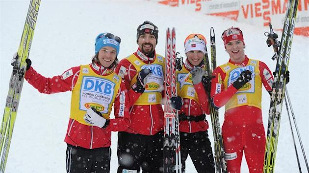 The Norway's combined ski team (L-R) Mikko Kokslien, Magnus Moan, Jan Schmid and Joergen Graabak pose after the World Cup Nordic Combined 2nd team competition in Oberstdorf, southern Germany, on Saturday, January 7, 2012. Norway won the competition, Germa