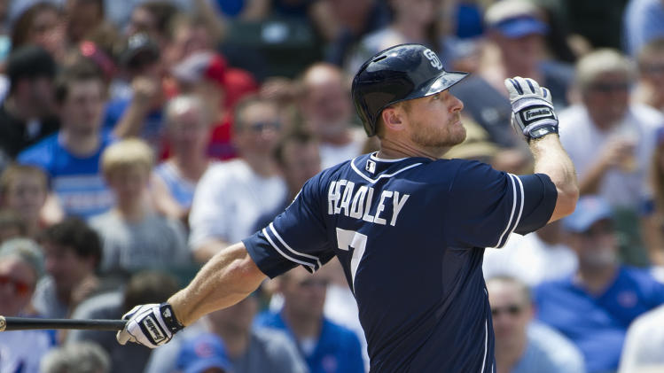 San Diego Padres' Chase Headley follows through on a solo home run during the fourth inning of a baseball game against the Chicago Cubs, Monday, May 28, 2012 in Chicago.  (AP Photo/Brian Kersey)