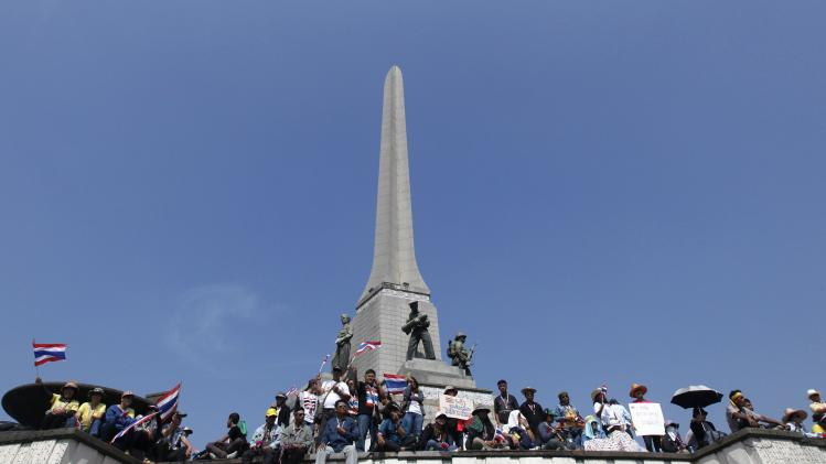 Anti-government protesters gather during a rally at Victory Monument in Bangkok