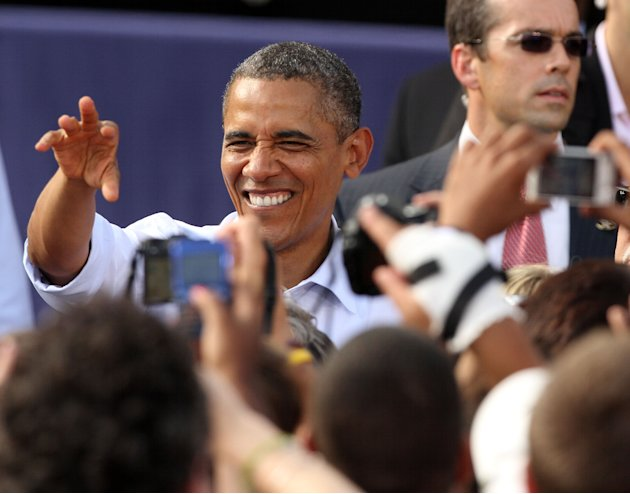 President Barack Obama greets supporters during a campaign stop Saturday, Aug. 18, 2012 in Rochester, N.H. (AP Photo/Jim Cole)