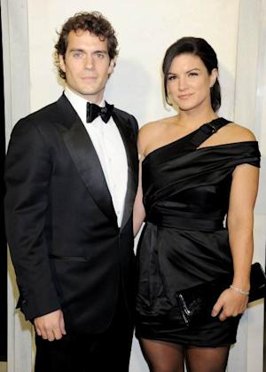 Henry Cavill and Gina Carano arrive at the Tom Ford cocktail party in support of Project Angel Food at TOM FORD on February 21, 2013 in Beverly Hills, Calif. -- Getty Premium