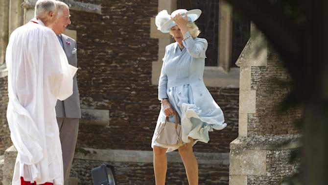 Britain's Prince Charles and his wife Camilla, Duchess of Cornwall, arrive for the christening of Princess Charlotte at the Church of St. Mary Magdalene in Sandringham