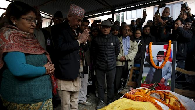 Nepalese Prime Minister KP Oli pays his respects to the late former Prime Minister Sushil Koirala in Kathmandu