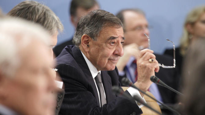 United States Secretary of Defense Leon Panetta, center, gestures while speaking during a round table of NATO Defense Ministers at NATO headquarters in Brussels on Wednesday, April 18, 2012. The United States and its NATO allies are readying plans to pull away from the front lines in Afghanistan next year as President Barack Obama and fellow leaders try to show that the unpopular war is ending. (AP Photo/Virginia Mayo)