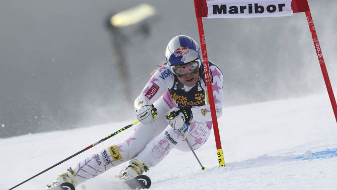 Lindsey Vonn, of the United States, speeds past a gate on her way to clock the third fastest time in an alpine ski, women's World Cup giant slalom, in Maribor, Slovenia, Saturday, Jan. 26, 2013. (AP Photo/Marco Trovati)