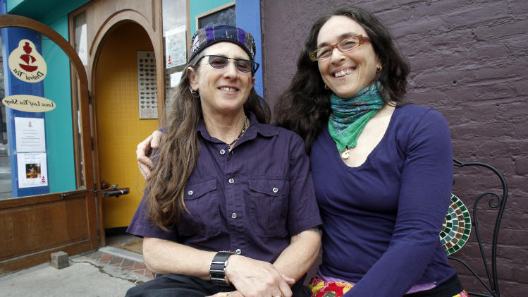 Stacy Jolles, left, and Nina Beck sit in front of the tea room on Thursday, May 10, 2012 in Burlington, Vt. The couple were part of the first lawsuit that brought civil unions to Vermont. President Barack Obama's declaration that he supports gay marriage may have lacked the urgency of Kennedy's push for the Civil Rights Act, or the force and finality of the Emancipation Proclamation, but in places key to the history of gay rights, it's being greeted as a major milestone. (AP Photo/Toby Talbot)