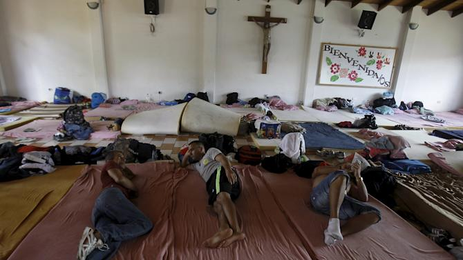 Cubans migrants rest at a shelter in La Cruz