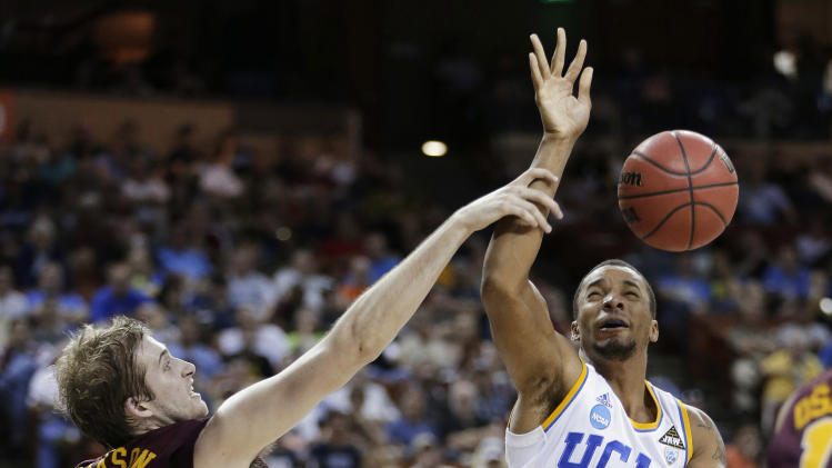 UCLA's Norman Powell (4) is fouled by Minnesota's Elliott Eliason (55) during the first half of a second-round game of the NCAA men's college basketball tournament Friday, March 22, 2013, in Austin, Texas. (AP Photo/Eric Gay)