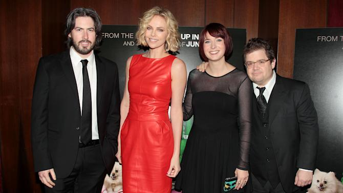 "Director Jason Reitman, from left, actress, Charlize Theron, writer Diablo Cody and actor Patton Oswalt attend the premiere of ""Young Adult,"" Thursday, Dec. 8, 2011 at the Ziegfeld Theatre in New York. (AP Photo/Starpix, Dave Allocca)"