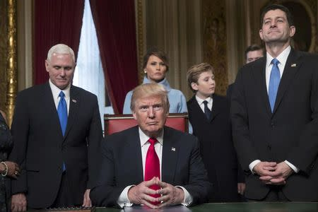 Trump, in Oval Office, signs first order on Obamacare