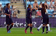 Japan's Kozue Ando (L), Nahomi Kawasumi (C) and Homare Sawa celebrate beating Canada after the 2012 London Olympic Games women's football match between Japan and Canada at The City of Coventry Stadium in Coventry, central England. The United States and Japan, the two favourites for women's football gold, both made winning starts