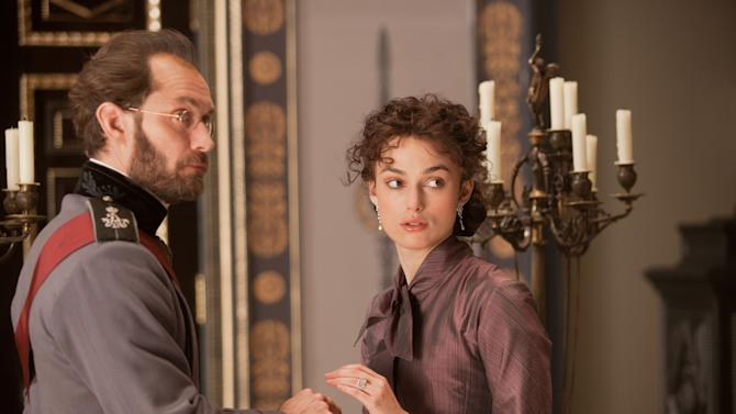 """This film image released by Focus Features shows Jude Law, left, and Keira Knightley in a scene from """"Anna Karenina."""" (AP Photo/Focus Features, Laurie Sparham)"""