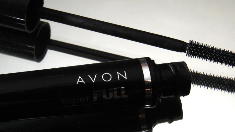 A Wednesday, July 28, 2010 file photo shows a container and brush of Super Full mascara by Avon, in North Andover, Mass. Avon Products Inc. says Tuesday, May 1, 2012 that its first-quarter profit tumbled 82 percent, hurt by a bigger restructuring charge, commodity costs and higher labor costs. The company is fending off makeup company Coty's takeover overture and adjusting to its new CEO, former Johnson & Johnson executive Sherilyn S. McCoy.  (AP Photo/Elise Amendola, File)