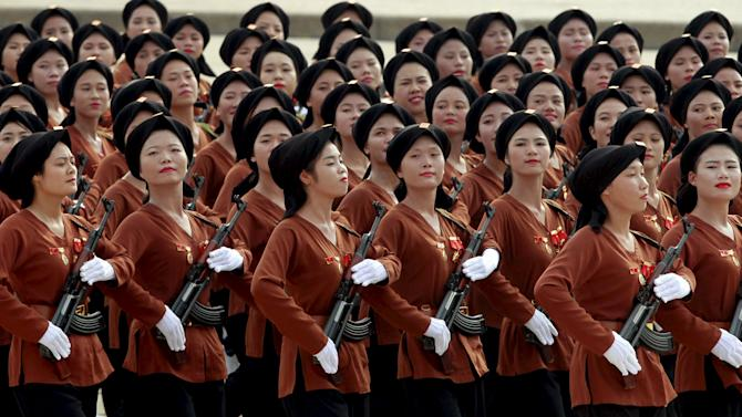 Northern Vietnamese female paramilitants march during a parade marking their 70th National Day at Ba Dinh square in Hanoi, Vietnam