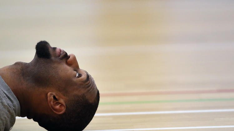 United States forward LeBron James lays on the court during a men's team basketball practice at the 2012 Summer Olympics, Saturday, July 28, 2012, in London. (AP Photo/Jae C. Hong)