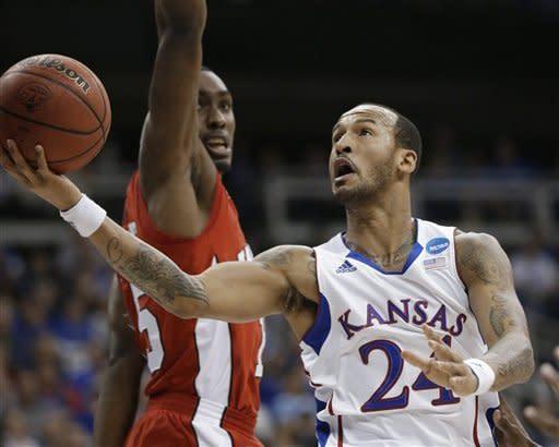 No. 1 Kansas survives Western Kentucky upset bid