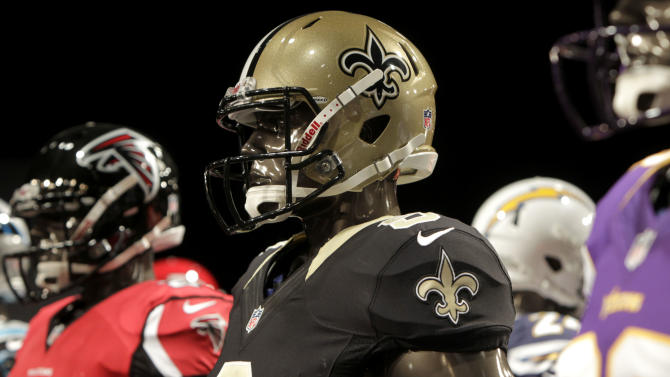 The new New Orleans Saints' uniform is displayed on a mannequin during a presentation in New York, Tuesday, April 3, 2012.  The NFL and Nike showed off the new look in grand style with a gridiron-styled fashion show at a Brooklyn film studio. (AP Photo/Seth Wenig)