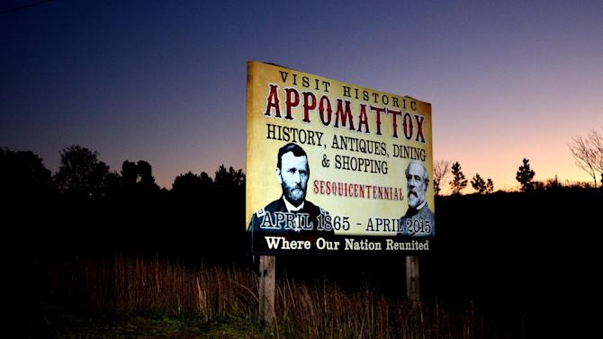 "This Nov. 8, 2012 photo shows a sign advertising the 150th anniversary of the Civil War outside Appomattox, Va. Signs around town call this the place ""where our nation reunited"" as the Civil War came to an end. But listen to people here and all over the country, or look at exit polls from the election, and you confront deep division, polarization. Red or blue. Left or right. Big government or small. Tea party or Occupy. Ninety-nine percent or one. Employed or out-of-work. Citizen or non-citizen. Black or white or brown. (AP Photo/Pat Jarrett)"