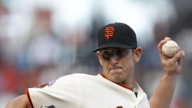 San Francisco Giants starting pitcher Eric Surkamp throws to the Houston Astros during the first inning of a baseball game in San Francisco, Saturday, Aug. 27, 2011. (AP Photo/Tony Avelar)