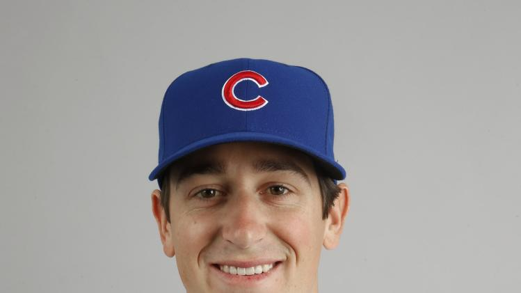 FILE - This is a 2014 file photo of Kyle Hendricks of the Chicago Cubs baseball team. The Cubs promoted Hendricks from Triple-A Iowa on Thursday, July 10, 2014, for his major league debut against the Cincinnati Reds. (AP Photo/Ross D. Franklin, File)