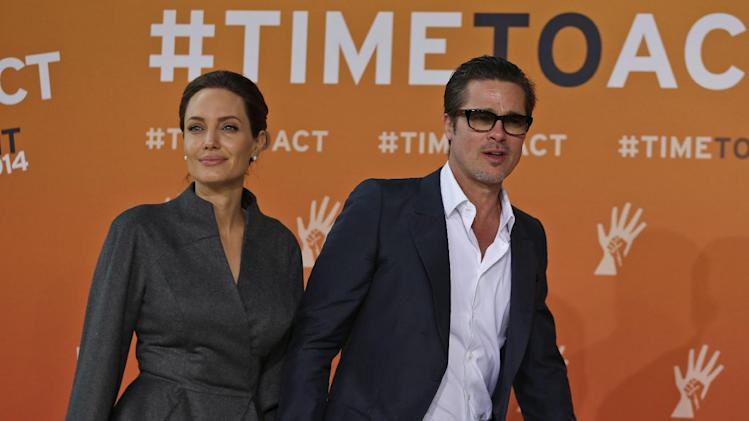 Angelina Jolie, left, special envoy of the United Nations High Commissioner for Refugees, and her partner Brad Pitt arrive at the 'End Sexual Violence in Conflict' summit in London, Friday, June 13, 2014. The Summit welcomes governments from over 100 countries, over 900 experts, NGOs, Faith leaders, and representatives from international organizations across the world. (AP Photo/Lefteris Pitarakis)