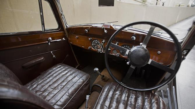 """This photo taken March 20, 2015, shows the interior of a 1948 1 ½ liter-engine Jaguar, restored by its owner in Islamabad, Pakistan. Sulaiman Abbasi, also a member of the Pakistani vintage cars club has for years worked on the 1948 1 ½ liter-engine Jaguar he inherited from his grandfather, photographing each sequence as he restored the sleek black saloon with so-called """"suicide doors"""" the kind that are hinged at the rear rather than the front. (AP Photo/B.K. Bangash)"""