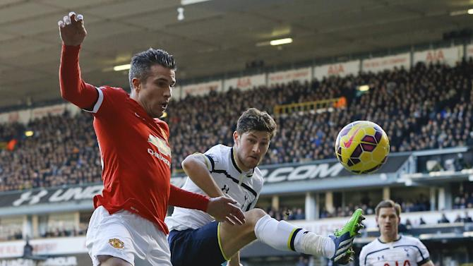 Tottenham's Vlad Chiriches, right, challenges for the ball with Manchester United's Robin van Persie during the English Premier League soccer match between Tottenham Hotspur and Manchester United at White Hart Lane Stadium in London, Sunday, Dec. 28, 2014. (AP Photo/Kirsty Wigglesworth)