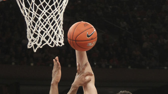 Pittsburgh's Steven Adams (13) goes up past Syracuse's C.J. Fair during the first half of an NCAA college basketball game at the Big East Conference tournament, Thursday, March 14, 2013 in New York. (AP Photo/Mary Altaffer)