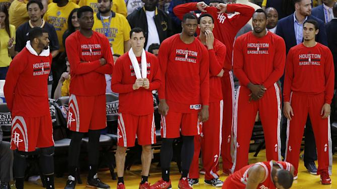 Houston Rockets players react during the second half of Game 5 of the NBA basketball Western Conference finals against the Golden State Warriors in Oakland, Calif., Wednesday, May 27, 2015. The Warriors won 104-90 and advanced to the NBA Finals. (AP Photo/Tony Avelar)