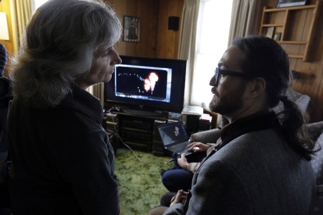 Sean Lennon talks with anti-fracking activist Vera Scoggins as they view videos of fracking, in Franklin Forks, Pa., Thursday, Jan. 17, 2013. Lennon and his mother, Yoko Ono, are on a bus tour of natural-gas drilling sites in northeastern Pennsylvania and visiting with residents who say they've been harmed by the controversial extraction process known as fracking. (AP Photo/Richard Drew)