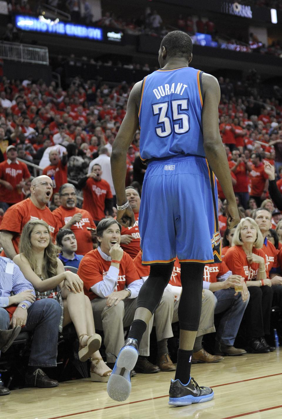 Oklahoma City Thunder's Kevin Durant (35) talks with Houston Rockets fans in the first quarter of Game 6 in a first-round NBA basketball playoff series Friday, May 3, 2013, in Houston. (AP Photo/Pat Sullivan)