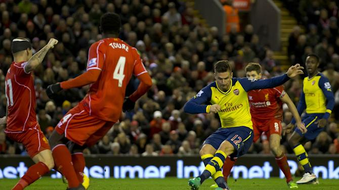 Arsenal's Olivier Giroud, centre right, scores against Liverpool during the English Premier League soccer match between Liverpool and Arsenal at Anfield Stadium, Liverpool, England, Sunday Dec. 21, 2014. (AP Photo/Jon Super)