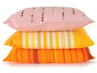pink, yellow and orange bed pillows