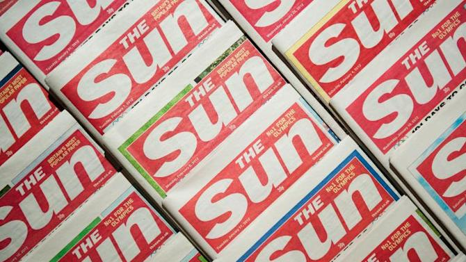 British tabloid The Sun has published a photo of a winking topless model, shooting down reports it had ended the controversial tradition that has featured in the newspaper since 1970