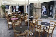 <p>A man sits at an empty coffee shop in Old Nicosia in the Cypriot capital on June 22. Cyprus announced late on Monday that it had requested assistance from its eurozone partners, becoming the fifth out the 17 countries that share the euro to seek a rescue.</p>