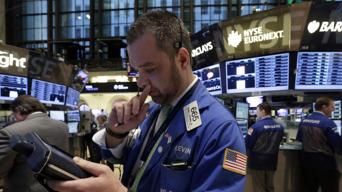Trader Kevin Lodewick, left, works on the floor of the New York Stock Exchange Tuesday, Feb. 5, 2013. Stocks are turning higher in early trading on Wall Street following a spike in home prices and strong earnings reports from Kellogg and other U.S. companies. (AP Photo/Richard Drew)
