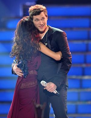"""Runner-up Jessica Sanchez, left, congratulates winner Phillip Phillips onstage at the """"American Idol"""" finale on Wednesday, May 23, 2012 in Los Angeles. (Photo by John Shearer/Invision/AP)"""