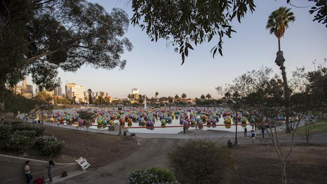 "Inflated spheres are pictured in MacArthur Park Lake as part of Portraits of Hope's exhibition ""Spheres at MacArthur Park"" in Los Angeles, California"