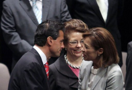 <p>Enrique Pena Nieto (left), shakes hands with National Action Party candidate Josefina Vazquez Mota in Mexico City this week. The PRI, the party that ran Mexico for most of the 20th century, appears set to return to national power Sunday led by their handsome presidential candidate and his glamorous TV-star wife.</p>
