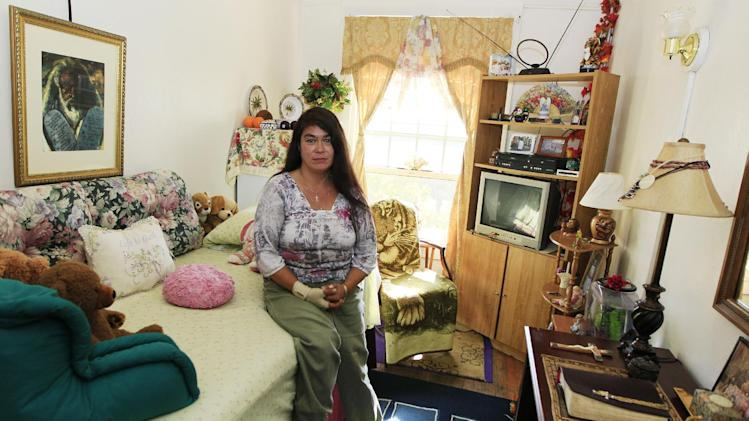 Sherene Julian sits inside her room at the Anna Louise Inn, Monday, Sept. 24, 2012, in Cincinnati. Western & Southern Financial Group wants the 103 year old home for women to leave the picturesque downtown neighborhood that they share in favor of a boutique hotel. (AP Photo/Al Behrman)